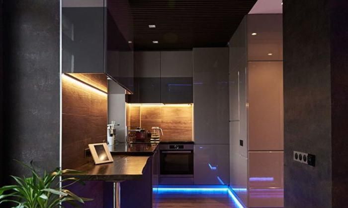 Design cucina high-tech in colore scuro.